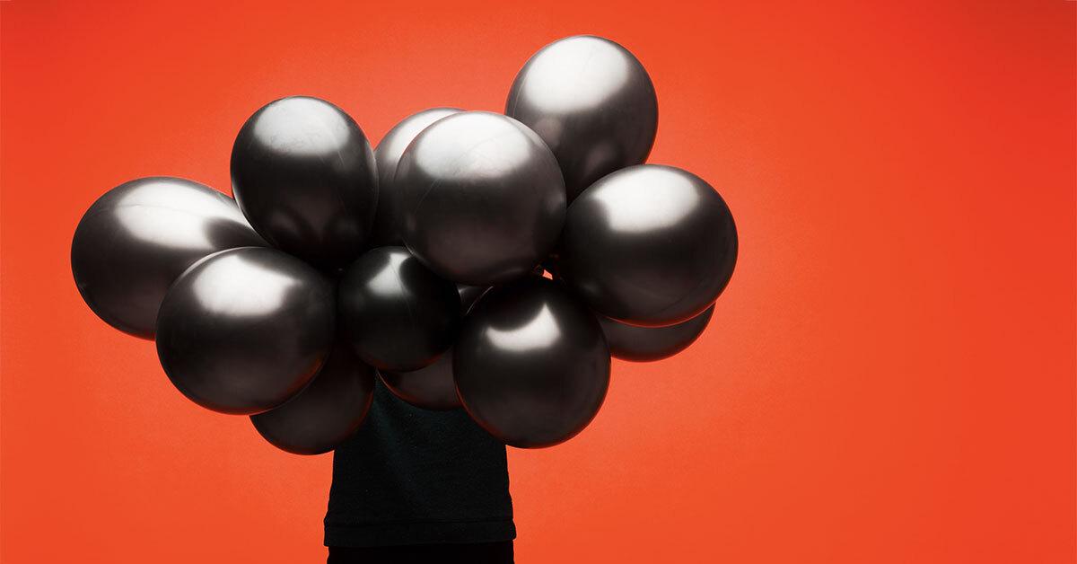 critical-thinking-skills-holding-balloons